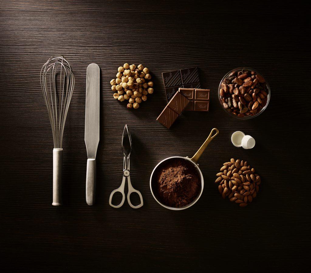 Lindt Cioccolato Ingredienti Nocciole Mandorle Polvere Cacao Frusta Spatola Food Shot by Fotografando