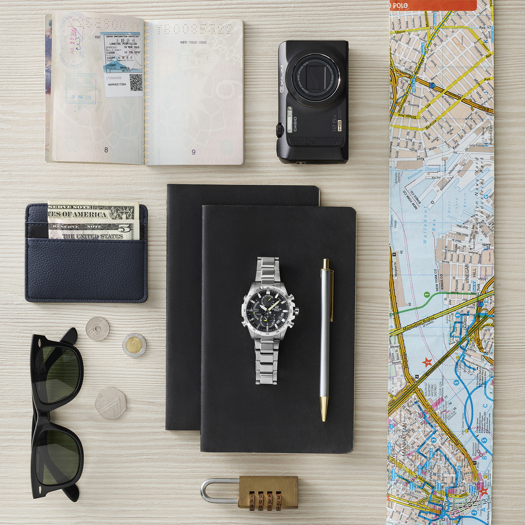 Man Map Glasses Coins Pen Locker Still Life Shot for Casio by Fotografando